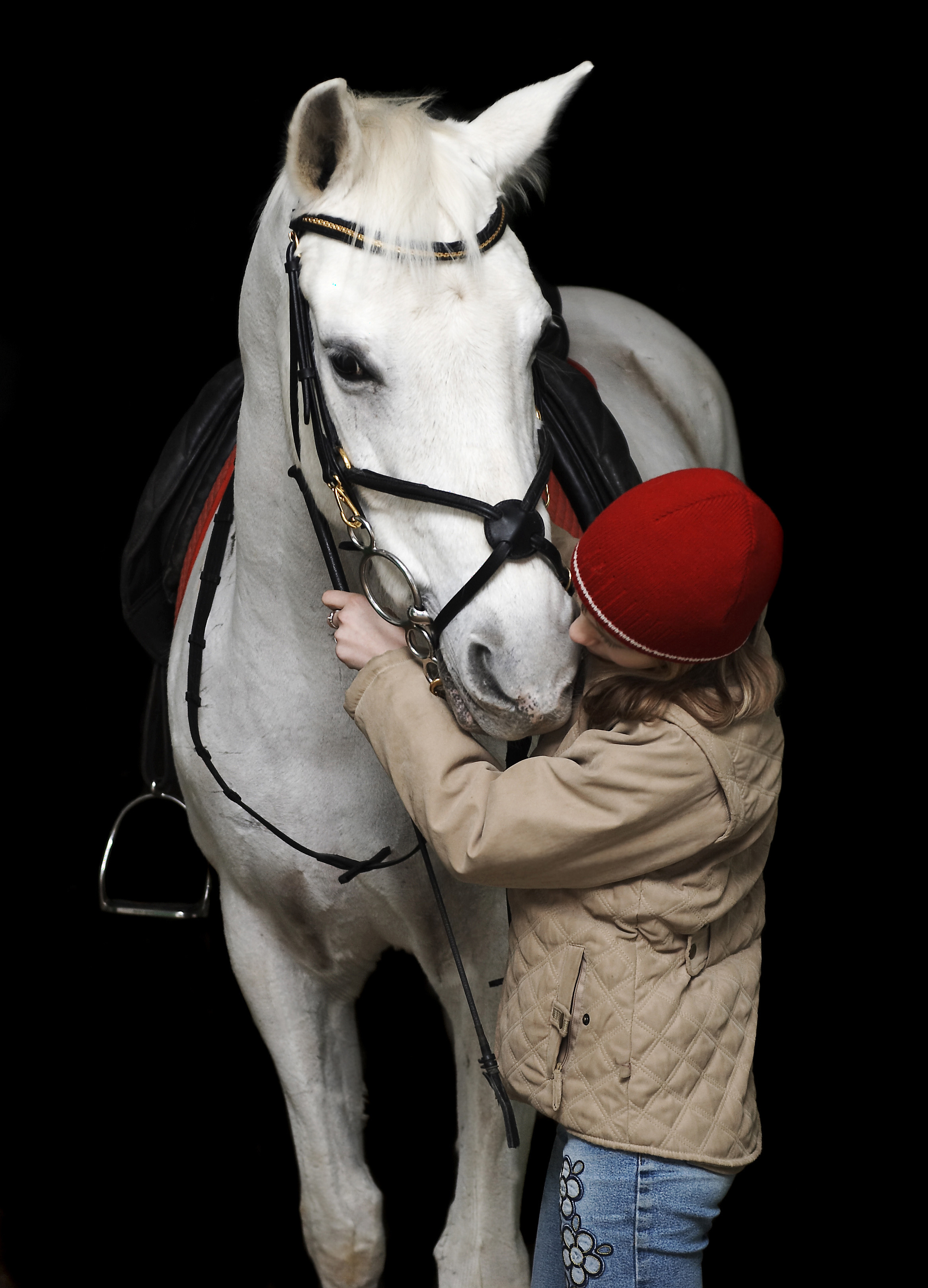 The girl with a white horse on a black background.